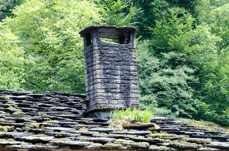 tolerate: Old smoky chimney