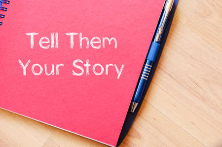 them: Tell them your story text concept write on notebook