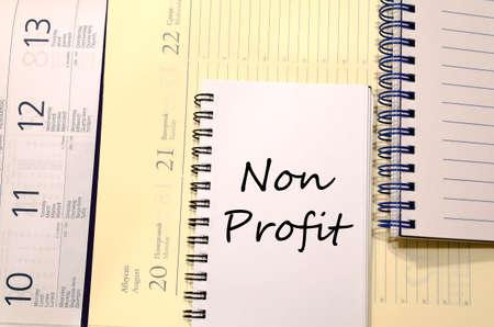 non profit: Non profit text concept write on notebook Stock Photo