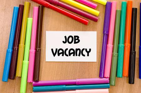 vacancy: Job vacancy written on memo over wooden background