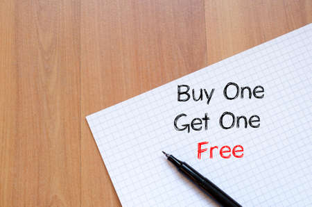 buy one: Buy one get one free text concept write on notebook