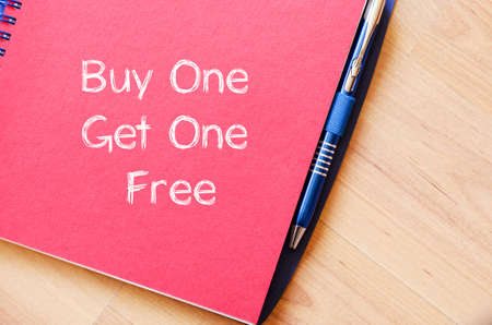 buy one get one free: Buy one get one free text concept write on notebook