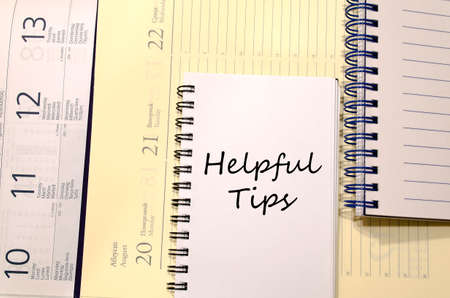 helpful: Helpful tips text concept write on notebook