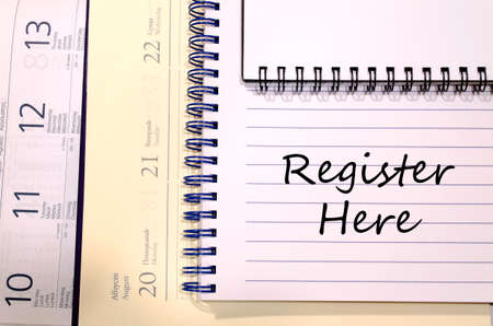 subscribe here: Register here text concept write on notebook Stock Photo