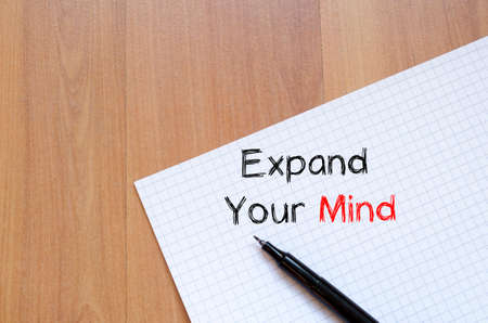 expand: Expand your mind text concept write on notebook