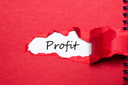 appearing: The word profit appearing behind torn paper