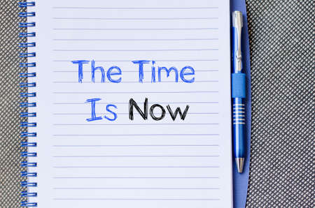 new opportunity: The time is now text concept write on notebook Stock Photo