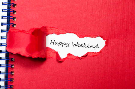 govern: The words happy weekend appearing behind torn paper Stock Photo