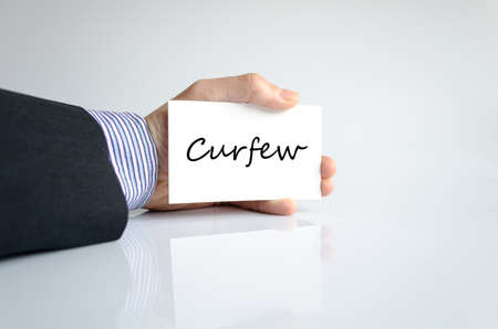 solider: Curfew text concept isolated over white background Stock Photo