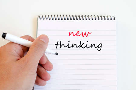 new thinking: New thinking text concept write on notebook