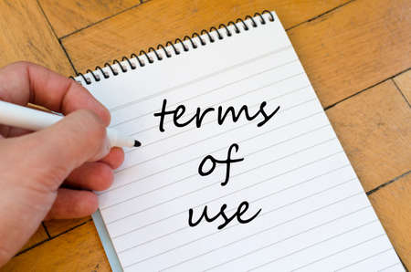 terms: Terms of use text concept write on notebook