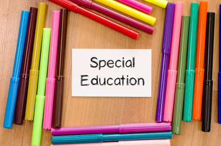 special education: Felt-tip pen and note on a wooden background and special education text concept