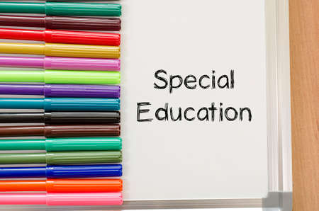 special education: Felt-tip pen and whiteboard on a wooden background and special education text concept