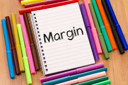 margin: Margin text concept over notepad background Stock Photo