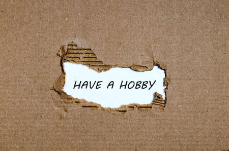avocation: The word have a hobby appearing behind torn paper Stock Photo