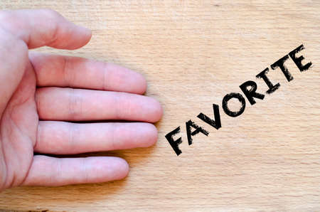 dearest: Human hand over wooden background and favorite text concept