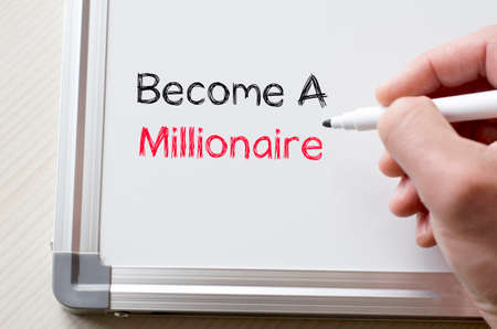 millonario: Human hand writing become a millionaire on whiteboard