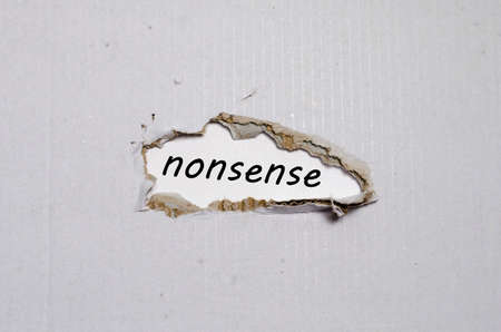 transcription: The word nonsense appearing behind torn paper