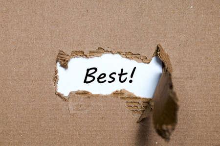 appearing: The word best appearing behind torn paper