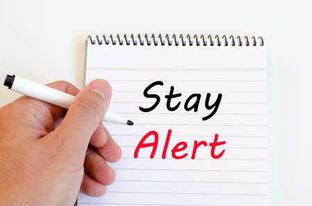 stay: Stay alert text concept write on notebook