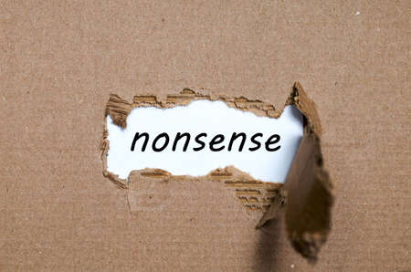 appearing: The word nonsense appearing behind torn paper