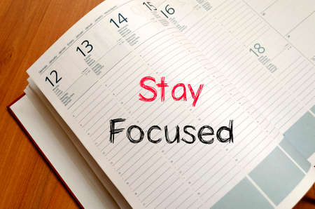 stay: Stay focused text concept write on notebook