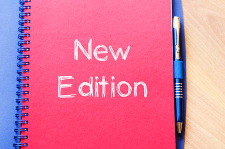 edition: New edition text concept write on notebook