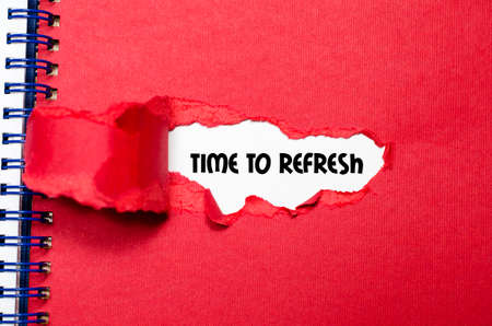 reformation: The word time to refresh appearing behind torn paper