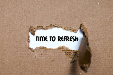 regenerate: The word time to refresh appearing behind torn paper