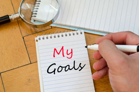 circumspect: Human hand over wooden background and my goals text concept Stock Photo