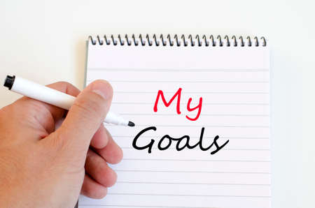 prudent: Human hand over wooden background and my goals text concept Stock Photo