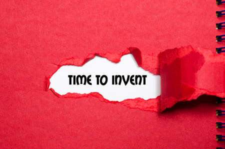 invent: The word time to invent appearing behind torn paper