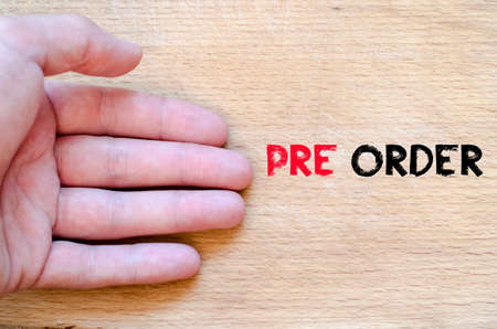 preorder: Human hand over wooden background and pre order text concept