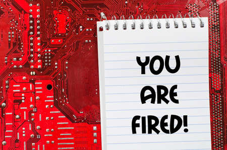 unemployed dismissed: Red old dirty computer circuit board and text concept
