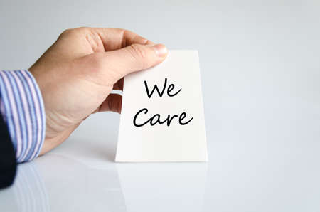 cordiality: We care text concept isolated over white background Stock Photo