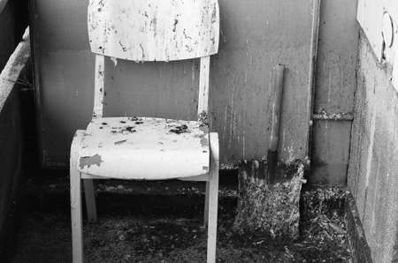 run down: Dirty old chair on black and white theme