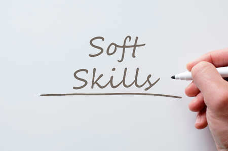 human hand writing soft skills on whiteboard stock photo picture