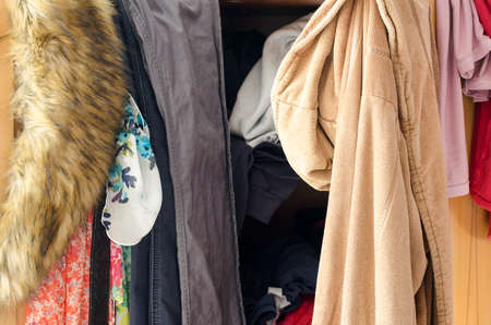 messy clothes: Pile of carelessly scattered clothes in wardrobe