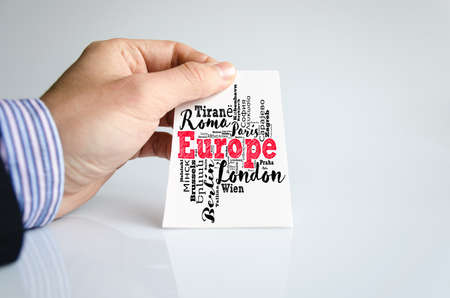European Union list of cities word cloud collage and human hand Stok Fotoğraf