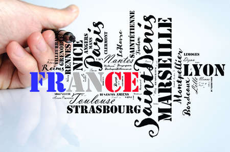 Localities in France word cloud travel concept over human hand background Stok Fotoğraf