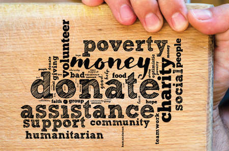 Donate word cloud collage with human hand