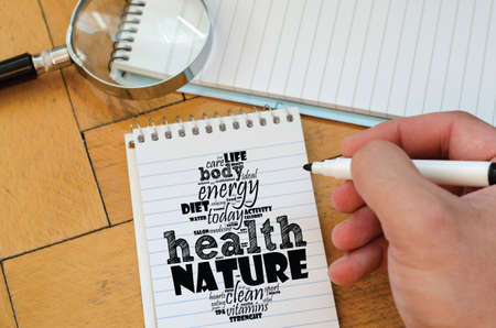 Health word cloud collage over notepad background