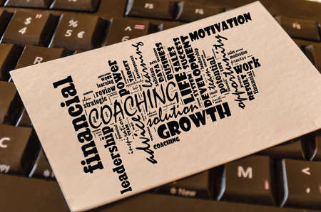 Coaching word cloud collage over keyboard background