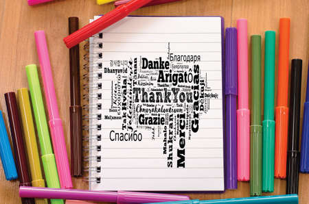 Thank You word cloud in different languages over notepad background Stok Fotoğraf