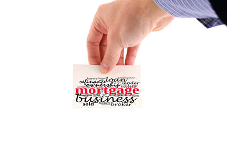Mortgage word cloud collage over note in human hand