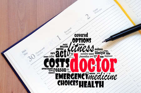 Doctor word cloud collage over notepad background Stok Fotoğraf