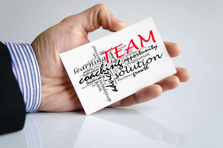 Team word cloud collage over human hand background