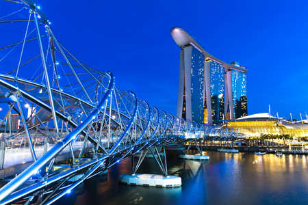 Helix bridge and Marina Bay area at night, Singapore.