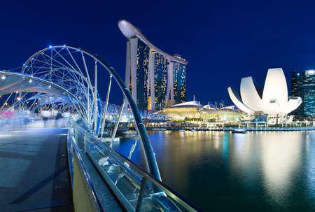 Helix bridge and Marina Bay area at night, Singapore. Editorial