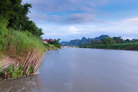 nam: Sunset over Nam Song river, Vang Vieng village, Laos